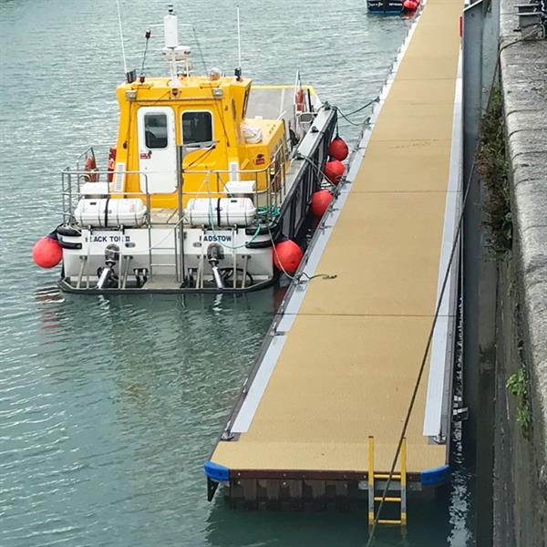 Bespoke fishing boat pontoons allow crew access when harbour dries out