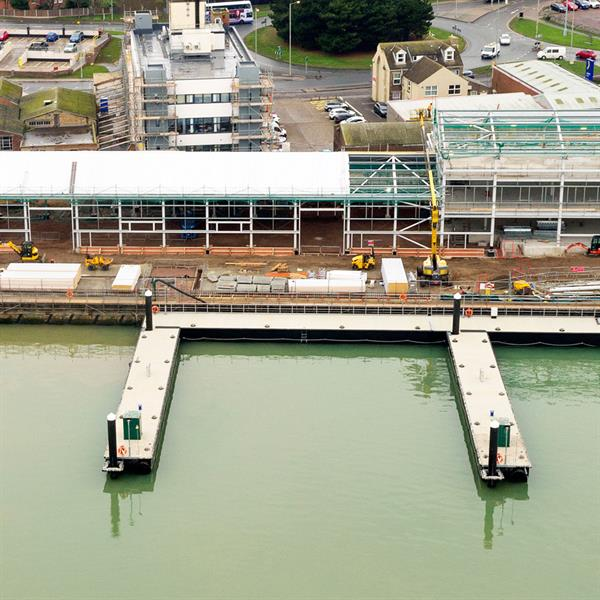 Ultra-heavy pontoons for wind farm support facility
